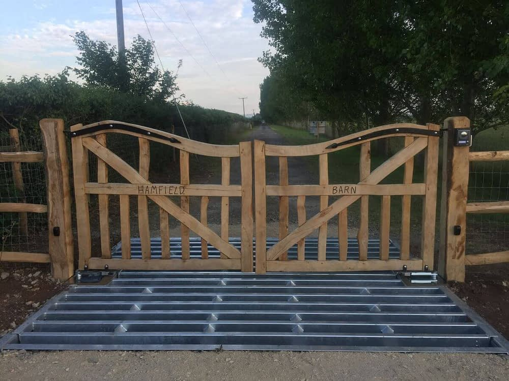 BESPOKE OAK GATES WITH AUTOMATION SET INTO CATTLE GRID