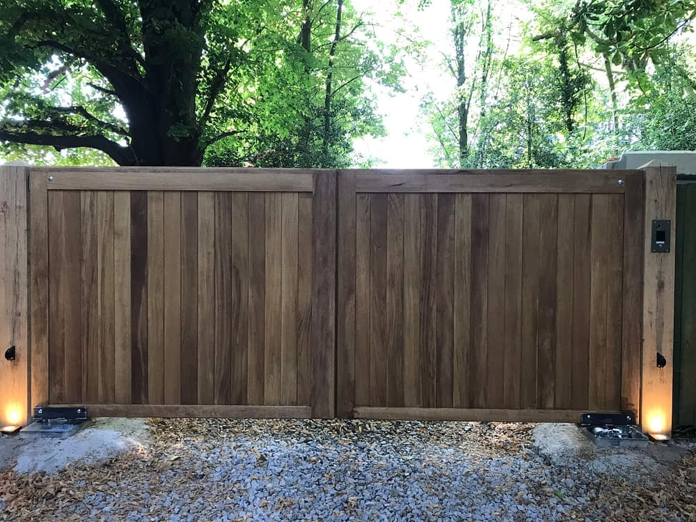 FLAT TOPPED IROKO GATES AND AUTOMATION WITH POST LIGHTING