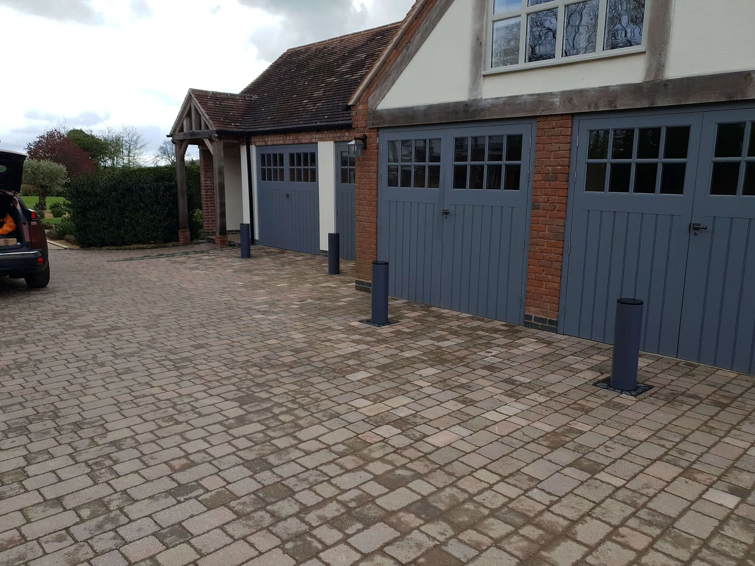 FOUR BFT SECURITY BOLLARDS INSTALLED IN FRONT OF GARAGES TO PREVENT CAR THEFT